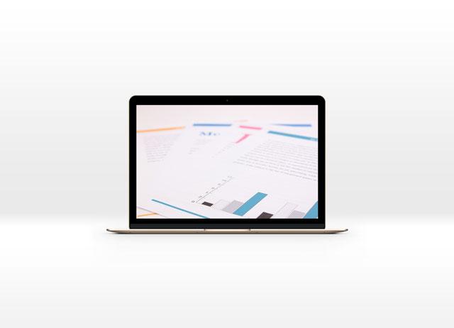 MacBookとグラフのイメージ