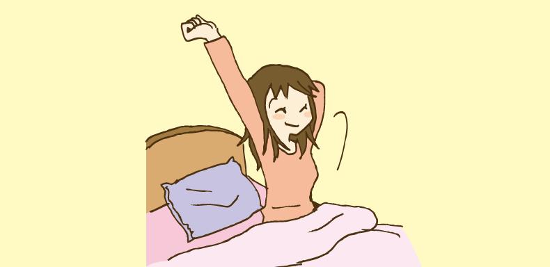 朝起きる女性